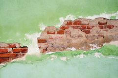 Old partly plastered brick wall Stock Image