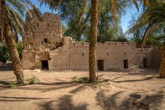 Old partly renovated arabian fort in Al Qattara Oasis stock image