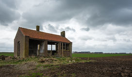 Old partly scrapped building under threatening storm clouds Royalty Free Stock Image