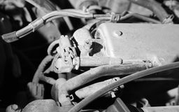 Old parts under the hood of a car Royalty Free Stock Photo