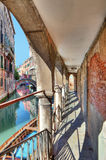 Old passage along canal. Venice, Italy. Stock Images