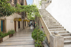 Old passageway in city with steps Stock Photos