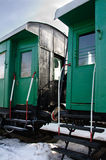 Old passener vans. Two old 4 axle vans for passenger with water heating and electricity. There started in Russia since 1928. Winter 2014. Russia Royalty Free Stock Photo