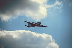 Old passenger plane on cloudy sky Stock Photography