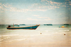 Old passenger ships parked at the shore in the ocean. Stock Images