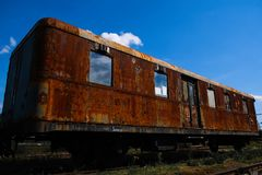 Old train melting away in the depot stock image