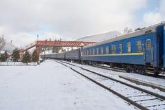 Old passenger wagons on railway station Stock Photos