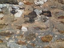 Old Patched Rock Wall. Royalty Free Stock Images