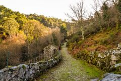 An old path leading out of Ermida - Portugal. The small village of Ermida - nestled in the mountains of the Paneda Geres National Park stock photos