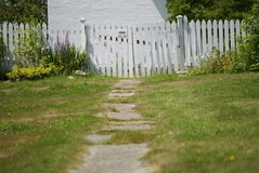 Old Path Leading To White Picket Fence Royalty Free Stock Images