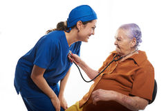 Old patient checking doctors heart beat. Patient checking doctors heart beat with stethoscope stock image