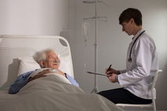 Old patient hearing bad news Stock Photography