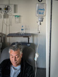Old patient man with a catheter in the hospital Stock Image