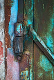 Old patterned hinge with rust decay Royalty Free Stock Images