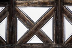 Old patterns. Half-timbered brown cross as part of an old house Royalty Free Stock Photography