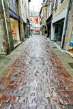 Old paved road in Dinan Stock Photo