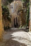 Old street in the Provence village of Gordes. An old pavede street in the Provence village of Gordes Royalty Free Stock Image