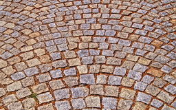Old pavement from colored stones. Abstract background or texture Stock Photos