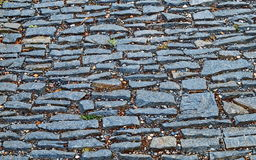 Old pavement from colored stones. Abstract background or texture Stock Photo