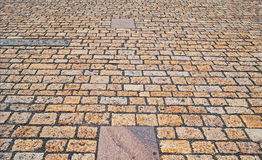 Old pavement from colored stones. Abstract background or texture Royalty Free Stock Photo