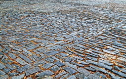 Old pavement from colored stones. Abstract background or texture Royalty Free Stock Image
