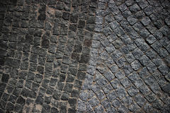 Old pavement. The road fragment paved by an old stone blocks Stock Photo