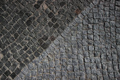 Old pavement. The road fragment paved by an old stone blocks Royalty Free Stock Image