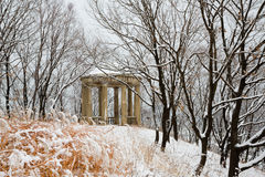 Old  pavilion in a city park after heavy snowfall Royalty Free Stock Photography