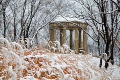 Old  pavilion in a city park after heavy snowfall Royalty Free Stock Photo
