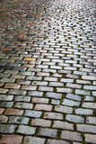 Old paving stone Stock Images