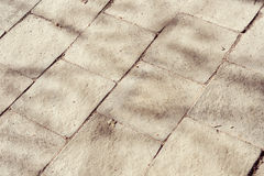 Old paving stone texture. Old beige paving stone texture. Structured background Royalty Free Stock Photos