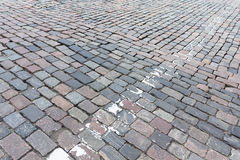 Old paving stones and remnants of road markings Royalty Free Stock Photography