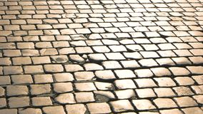 Old paving stones texture. Road surface and sunlight stock footage
