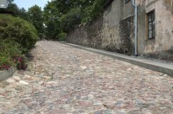 Old paving in the Old Town. Ancient boulder paving in Latvian small town royalty free stock photo