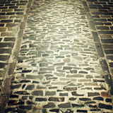 Old paving useful as a background - retro filter. Stock Photos