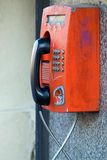 Old payphone closeup and located outdoor on a wall Stock Images