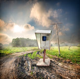 Old payphone in the field. Old payphone on a road in the field royalty free stock photos