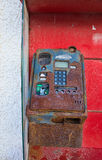 Old payphone. Out of order payphone in a very bad state stock images