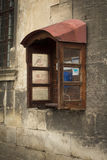 Old payphone on the stone wall. Lviv, Ukraine royalty free stock images