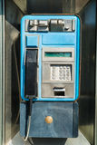 Old payphone. In working order inside a phone box royalty free stock photography