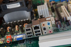 Old pc motherboard. Old dustu pc motherboard closeup Royalty Free Stock Image