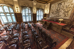Old PCA Courtroom. View of the the Permanent Court of Arbitration courtroom with an empty audience facing the judges benches inside the Peace Palace, Den Haag Royalty Free Stock Photography