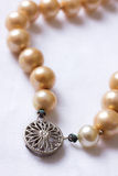 Old Pearls. Closeup image of the clasp on a string of antique pearls Royalty Free Stock Image