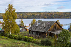 Old peasant house on the shore of forest lake Royalty Free Stock Image