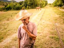 Old farmer with straw hat. Old peasant in a rural setting of Valle de los ingenios near Trinidad Stock Photos
