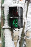 Old pedestrian crossing lights at wintertime.  Royalty Free Stock Photography