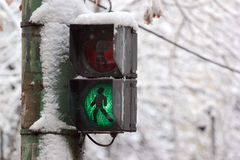 Old pedestrian crossing lights at wintertime.  Stock Photography