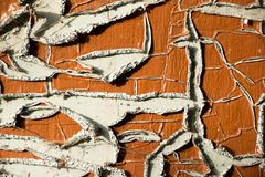 Old and peeled creaky paint. In course of time the paint of white tone peeled off the old planks and crackled, wood texture, background, colorful, cracks in Stock Photo