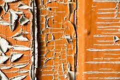 Old and peeled creaky paint. In course of time the paint of white tone peeled off the old planks and crackled, wood texture, background, colorful, cracks in Royalty Free Stock Photos