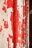 Old and peeled creaky paint. In course of time the paint of white tone peeled off the old planks and crackled, wood texture, background, colorful, cracks in Stock Photos